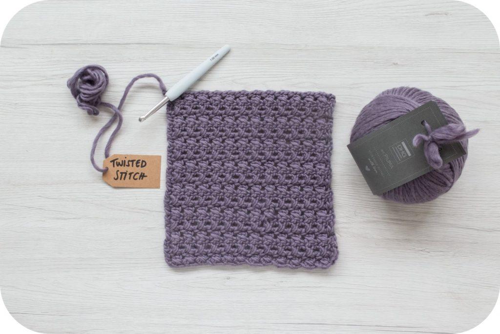Punto incrociato con filato di lana