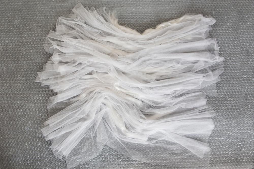 tulle lavorato con le fibre