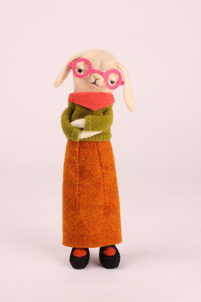 A fluffy rabbit wearing glasses made using thermoformable felt