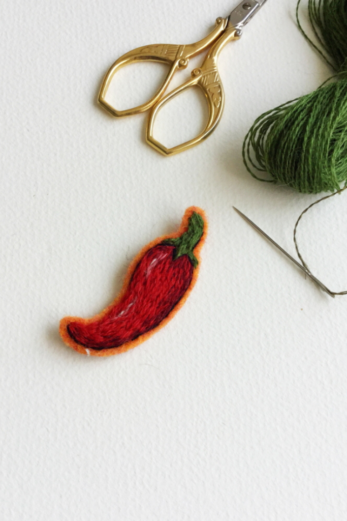 A chilli embroidered with Quipa