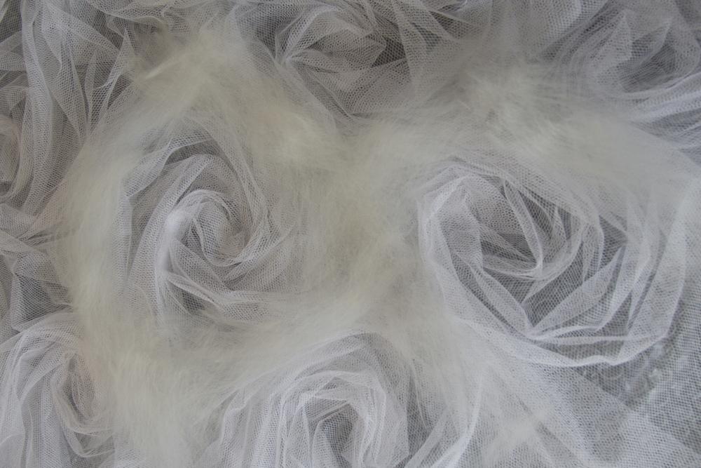 tops di lana merino extra fine e tulle